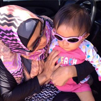 Mum with baby in Adventure Banz Pink Check sunnies