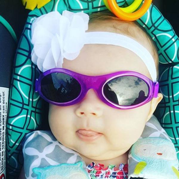 Baby in Adventure Banz Purple sunglasses