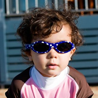Baby Banz Adventure Banz Blue Dot sunglasses worn by a girl