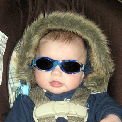 Baby wearing Baby Banz Adventure Banz Camo Blue sunglasses