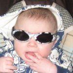 Baby Banz Adventure Banz Camo Grey sunglasses on a baby