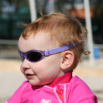 Baby Banz Adventure Banz Lavender Flowers sunglasses on a toddler