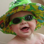 Baby Banz Adventure Banz Lime Green sunglasses on a happy baby