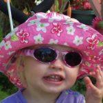 Baby Banz Adventure Banz Camo Pink sunglasses on child