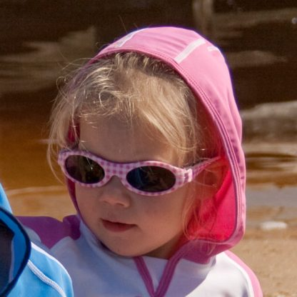 Child wearing Banz Adventure Banz Pink Check sunglasses