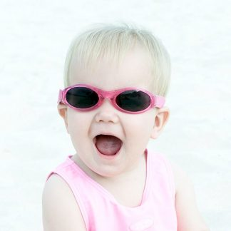 Baby wearing Adventure Banz sunglasses in Pink