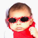 Baby Banz Adventure Banz Red Dot sunglasses on a baby