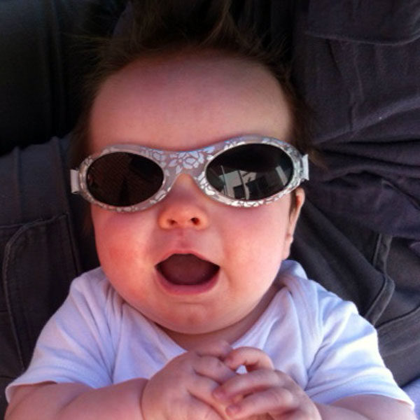Baby Banz Adventure Banz sunglasses in Silver Leaf on a baby