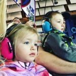 Girl and boy watching the show in Protective Earmuffs