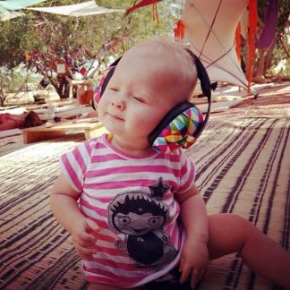 Baby swaying to the music in Geo Mini Earmuffs