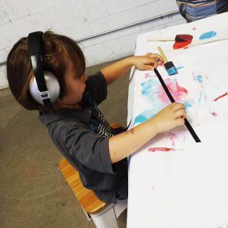 Child wearing Mini Muffs in Silver ar preschool