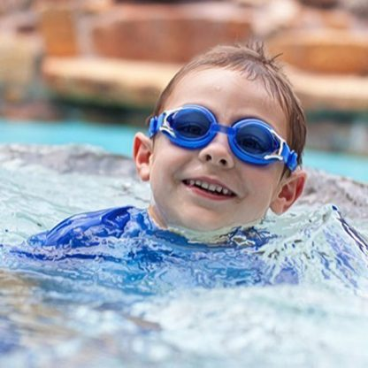 Boy swimming in Blue Swimming Goggles