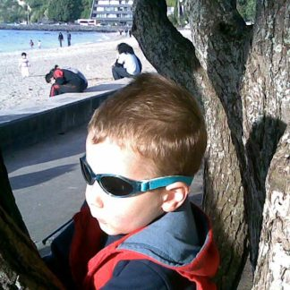 Baby Banz Adventure Banz Aqua sunglasses at the beach