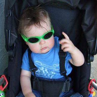 baby in stroller wearing lime sunglasses