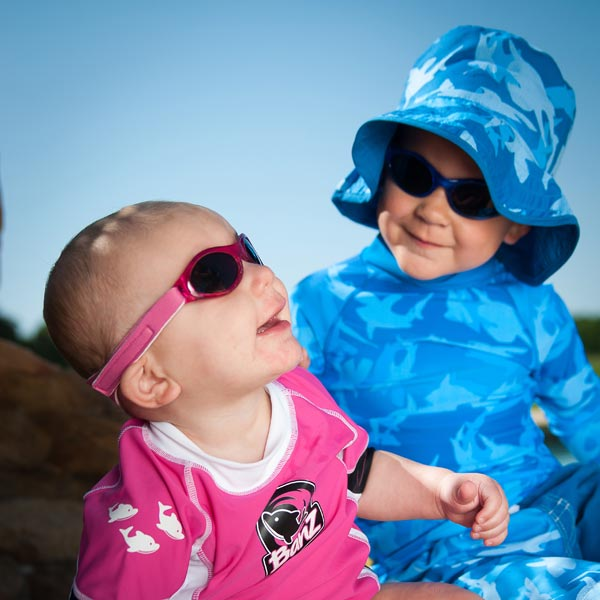 Boy and baby in sunglasses