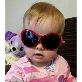 Baby in Retro Banz Berry Pink sunglasses