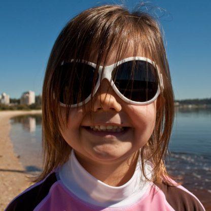 Girl in Retro Banz Cool White sunglasses