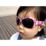 Girl in Retro Banz Pink Diva sunglasses