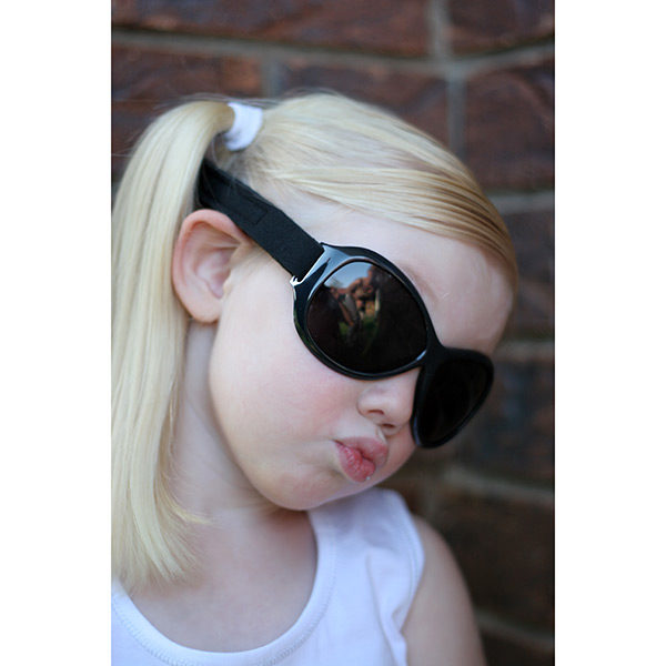 Girl wearing Retro Banz sunnies in Midnight Black