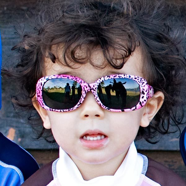 Girl in JBanz Pink Leopard sunglasses