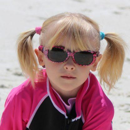 Girl in JBanz Pattern Pink Leopard sunglasses