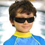 Boy in JBanz Wraparound Black sunglasses