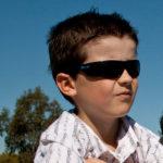 Boy wearing JBanz Wraparound Black sunnies