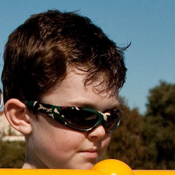 Boy in JBanz Patternz Camo Green sunglasses