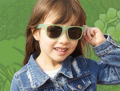 Girl wearing JBanz Chamelon Blue -> Green colour change sunglasses