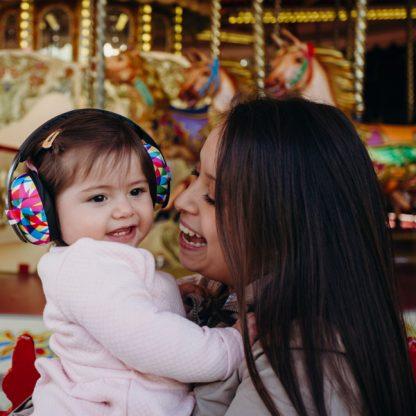 Girl wearing Mini Earmuffs Geo with Mum