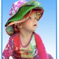 baby wearing lots of Baby Banz sunhats!