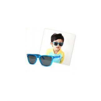 Picture of boy beside blue sunglasses