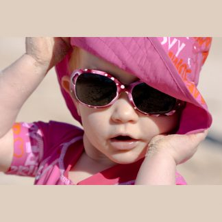 Child wearing Maroon Dots sunglasses