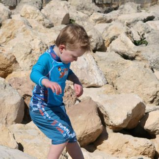 Boy wearing a Blue Surfer/Graffiti outfit