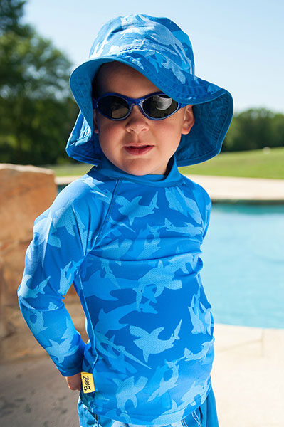 Boy in long-sleeved Fin Frenzy Pattern rash shirt