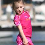 Girl in short-sleeved Pink Graffiti rash shirt