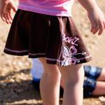 Girl in a Pink/Mocha swim skirt