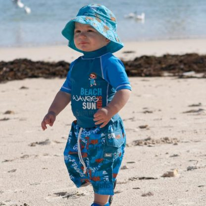 Toddler in a short-sleeved Blue Surfer/Graffiti outfit