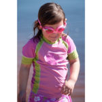 Girl in short-sleeved Pink/Green rash shirt