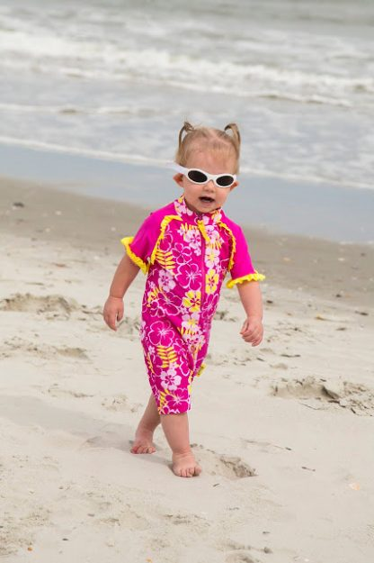 Small girl wearing a Sun Blossom swimsuit