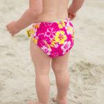 Little girl in a Sun Blossom Print swim nappy
