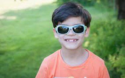Boy wearing JBanz Flexerz Aqua/Lime sunglasses