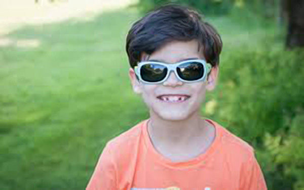 Boy wearing JBanz Flexerz Aqua/Lime sunglasses