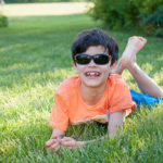 Boy wearing JBanz Flexerz Black/Orange sunglasses