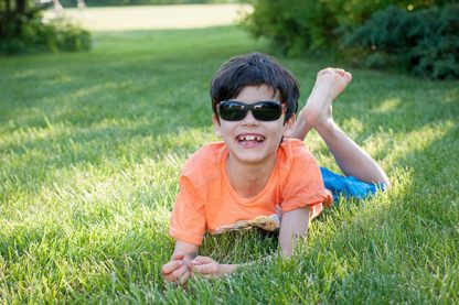 Boy wearing JBanz Flexerz Orange/Black sunglasses