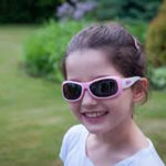 Girl wearing JBanz Flexerz Pink/White sunglasses