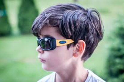 Boy wearing JBanz Flexerz Mustard/Black sunglasses