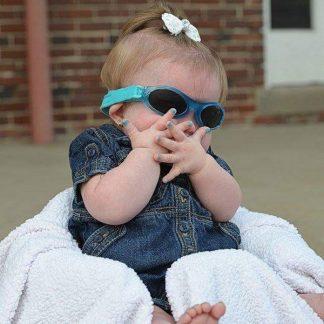 Cute baby girl in Adventure Banz Aqua sunglasses
