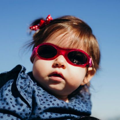 Little girl in Adventure Banz Pink sunglasses