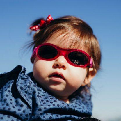 Little girl in Adventure Banz Pink sunglasses